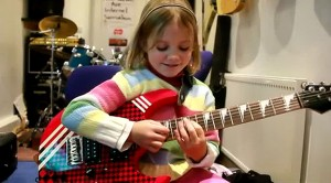 "Adorable 8-Year-Old Girl Absolutely NAILS ""Sweet Child O' Mine"""