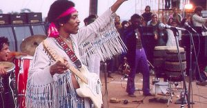 "Happy Birthday, Jimi Hendrix! Here's A Look Back At His Iconic Woodstock ""Voodoo Chile"" Performance"