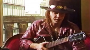 Caught On Camera: Stevie Ray Vaughan Jams Acoustic Guitar In Rare Studio Footage
