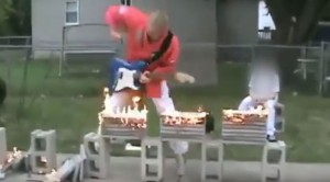 Man Chops Fiery Blocks Into Pieces While Shredding Guitar, You Won't Believe This
