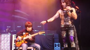 Kid Boots Guitarist Off Stage, Steals Show
