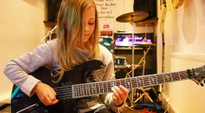10-Year-Old Girl Picks Up Guitar, But What She Does Next Is Mindblowing