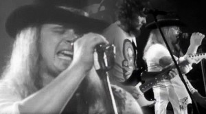 "Flashback: Lynyrd Skynyrd Bring Thunderous ""Gimme Three Steps"" To Convention Hall"