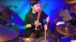 "Caught On Camera: 9-Year-Old Drummer Jams KISS Classic ""War Machine,"" And It Rocks"