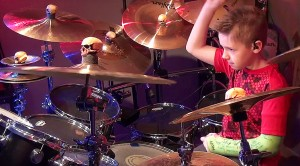 "9-Year-Old Drum Sensation Turns It Way, Way Up For Quiet Riot's ""Bang Your Head"""