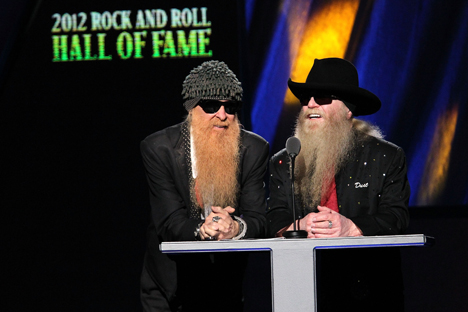 CLEVELAND, OH - APRIL 14: Presenters Billy Gibbons and Derek Trucks of ZZ Top speak on stage during the 27th Annual Rock And Roll Hall Of Fame Induction Ceremony at Public Hall on April 14, 2012 in Cleveland, Ohio. (Photo by Kevin Kane/WireImage)