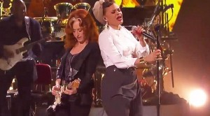 "Blues Queen Bonnie Raitt Dishes Out Fiery ""Love Sneakin' Up On You"" Duet With Andra Day"