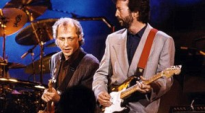 "Worlds Collide When Eric Clapton And Mark Knopfler Join Forces For ""Cocaine,"" ""Sultans Of Swing"""