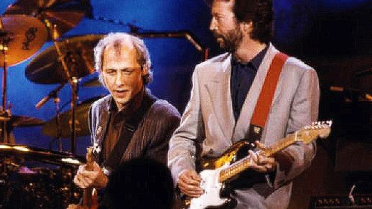 "Worlds Collide When Eric Clapton And Mark Knopfler Join Forces For ""Cocaine,"" ""Sultans Of Swing"" 