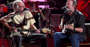 "Eric Clapton And JJ Cale Show How It's Really Done In All-Star Performance Of ""Anyway The Wind Blows"""