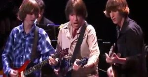 "Proud Papa John Fogerty Beams With Pride As Sons Shane & Tyler Trade Licks On ""Up Around The Bend"""