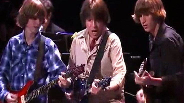 "Proud Papa John Fogerty Beams With Pride As Sons Shane & Tyler Trade Licks On ""Up Around The Bend"" 