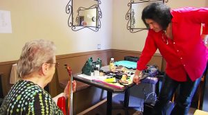 Gene Simmons Hands Bass To 81 Year Old Woman – Immediately Gets Schooled