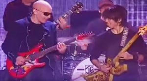 "Joe Satriani Brings Young Rocker On Stage—Both Shred Mind-Blowing Duet Of ""Canon Rock"""