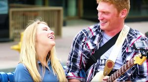 """Guy Serenades Woman With Hilarious AC/DC """"Thunderstruck"""" Flash Mob—This Will Make You Smile!"""
