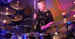 """A Broken Arm Is No Match For This Kid's Killer Cover Of AC/DC's """"Back In Black"""""""