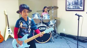 Brother And Sister Team Up For Fantastic Guitar And Drum Duet Of This AC/DC Classic!