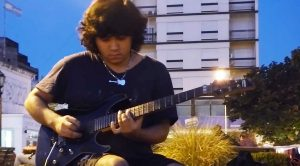 Young Street Musician Shreds 'Sweet Child Of Mine' And People Immediately Reach For Their Phones…