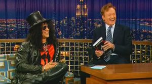 Slash Struggles To Contain His Laughter When He Hears Conan O'Brien's Hilarious Axl Rose Impression!