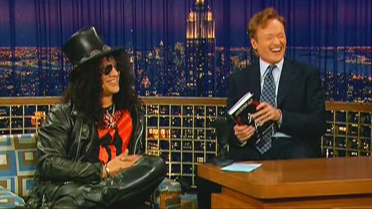 Slash Struggles To Contain His Laughter When He Hears Conan O'Brien's Hilarious Axl Rose Impression! | Society Of Rock Videos