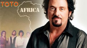 """Bluegrass Legend Offers Twangy Cover Of Toto's """"Africa,"""" And We Love Steve Lukather's Reaction"""