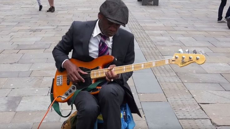 Street Performer Uses Bass Guitar To Channel Jimi Hendrix And We Can't Stop Watching! | Society Of Rock Videos