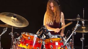 Teenage Girl Channels Her Inner-Texan For Groovin' Drum Cover Of ZZ Top's 'Sharp Dressed Man'!