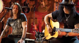 Slash And Some Friends Take It Down A Notch For An Acoustic Jam That'll Brighten Your Day!