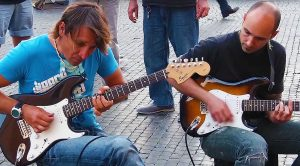 "Italian Street Performers Halt Pedestrians With Masterful Cover Of Dire Strait's ""Sultans of Swing""!"