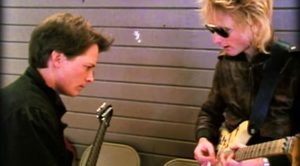 Footage Leaks of Michael J. Fox Learning Guitar Behind The Scenes While Filming 'Back To The Future!'