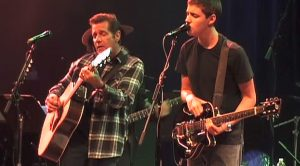 "Flashback To When Glenn Frey And His Son, Deacon, Tore Up Eric Clapton's ""Change The World"" Together"