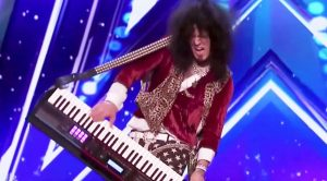 80's Rocker Steps On America's Got Talent Audition Stage, And Wows Judges With High Octane Keytar Solo!