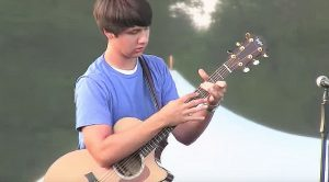 Young Man Amazes Crowd With Crazy-Slap Guitar Instrumental That Is On A Whole Other Level!