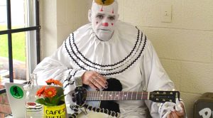 "7 Foot Depressed Clown Covers A Beatles Classic, And His Guitar Isn't Only Thing ""Weeping"""