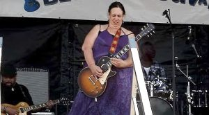 You Won't Believe Your Eyes When You See How This Mama Plays A Guitar!