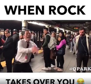 Guy Literally Rocks Out In The Streets – The Look On The Crowd's Faces Is Hilarious