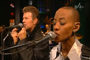 "David Bowie Performs ""Under Pressure"" But Keep Your Eyes On The Bassist"