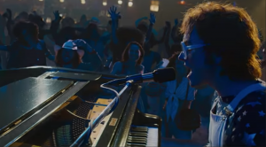 "'Rocketman' Actor Belts Elton John's ""Tiny Dancer"" In Explosive New Trailer"