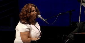 "Watch Aretha Franklin's Piano Rendition Of ""O Tannenbaum"""