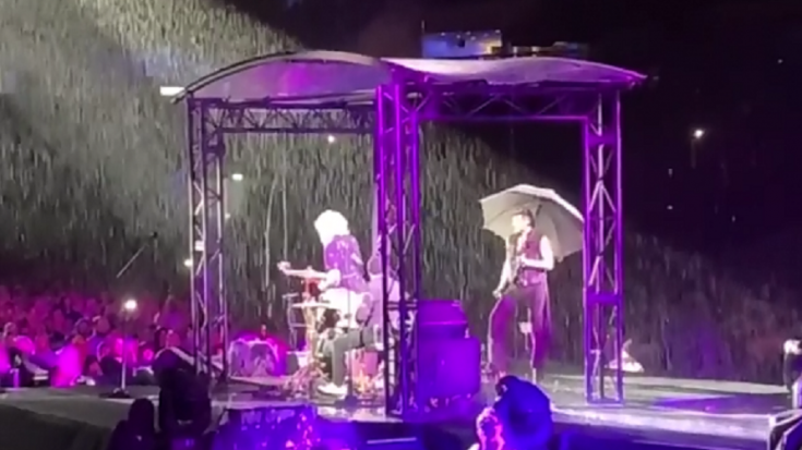 "Queen + Adam Lambert Pushed Forward With ""Wettest Gig"" They Played 
