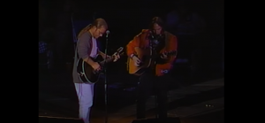 "Watch | Neil Young & Warren Zevon Perform ""Splendid Isolation"" Back In 1993"