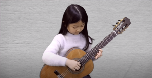"""Six Year Old Girl Covers """"Hotel California"""" As A One-Man Band"""