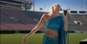 "Miley Cyrus Performs Beatles' ""Help!"" In Empty Rose Bowl"