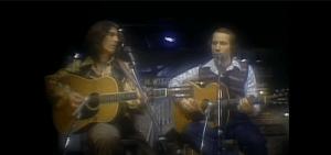 1976: Paul Simon & George Harrison Perform 'Homeward Bound' In SNL