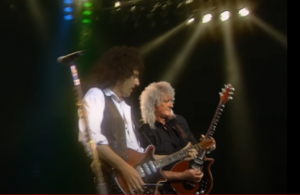 """Brian May Performs With His Younger Self With """"Back to the Light"""" Video"""