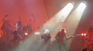 Watch Brian May Surprises Fans In Roger Taylor Show